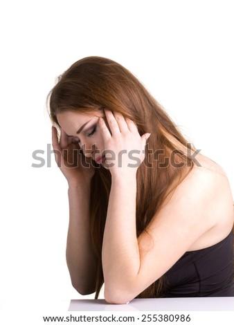 Headache - Woman holding her head on white - Stock Image - stock photo