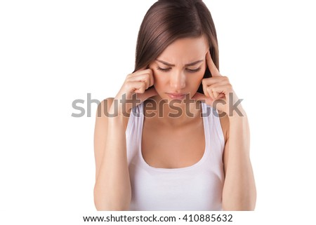headache. young woman holding her head with her hands. migraine