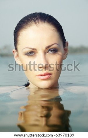 Headhost of the beautiful woman in the water. Natural light and colors - stock photo