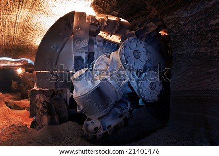 heading machine in a salt mine (underground mining) - stock photo