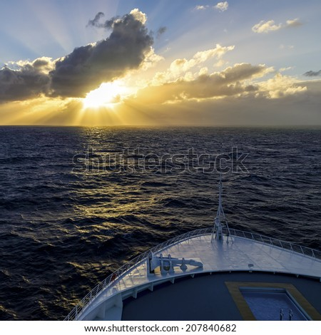 Heading toward the sunset in the middle of the ocean while traveling on a cruise liner.