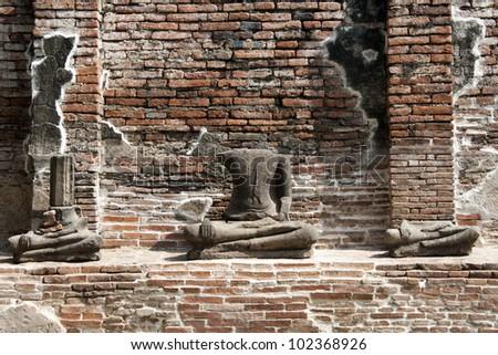 headless Buddha ruins at the temple of Wat Chai Wattanaram in Ayutthaya near Bangkok, Thailand. - stock photo