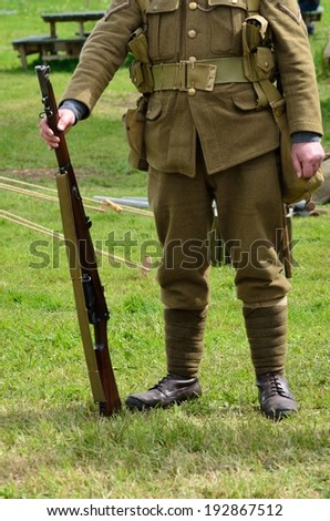 Headless soldier at attention - stock photo