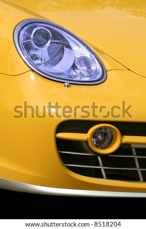 Headlight and cowl of the chic car - stock photo