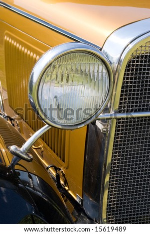 headlight fan in american old gold car - stock photo