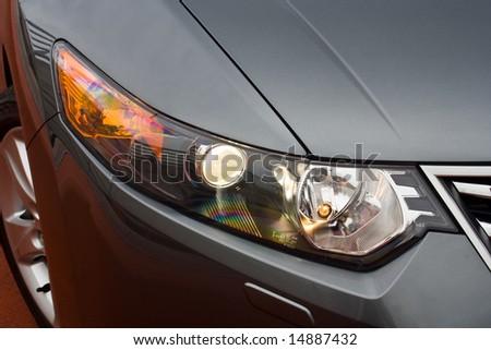 headlight of a business sedan - stock photo