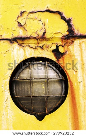 headlight of old crane in the fishing port - stock photo