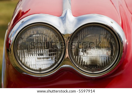 Headlight on a red american car - stock photo