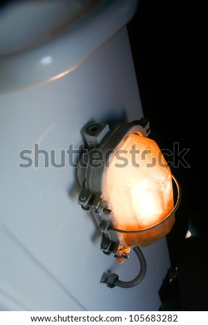 headlight on the shiny surface of a train of white color with the reflections and refraction - stock photo