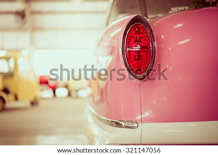 Headlight rear lamp vintage car - selective focus & vintage effect style - stock photo