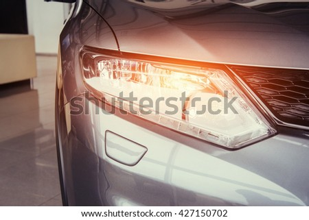 Headlights and hood of sport car