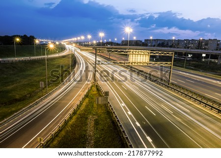 headlights racing machines.The ring road interchange in St. Petersburg at evening illumination