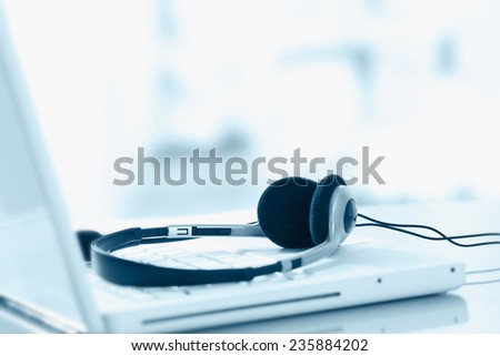 Headphone and keyboard - stock photo