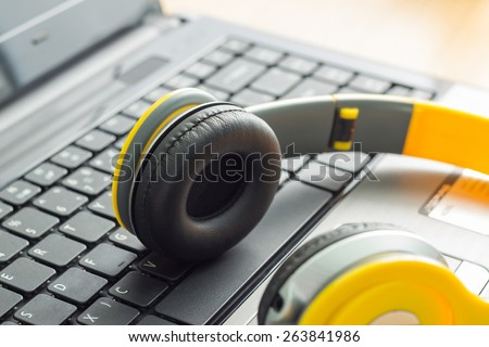 Headphone and Laptop. Enjoys digital music - stock photo