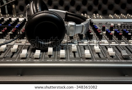 headphone,sound mixer background. - stock photo