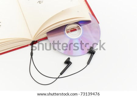 headphones and red books (audio book concept) - stock photo