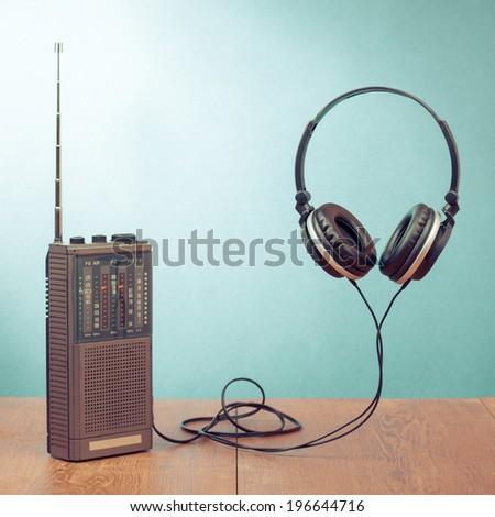 Headphones and retro radio conceptual photo - stock photo
