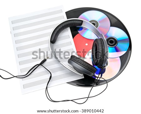 headphones, CDs and vinyl records isolated on white background - stock photo