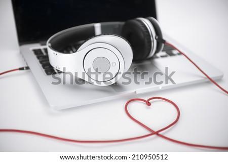 Headphones heart on white background  - stock photo