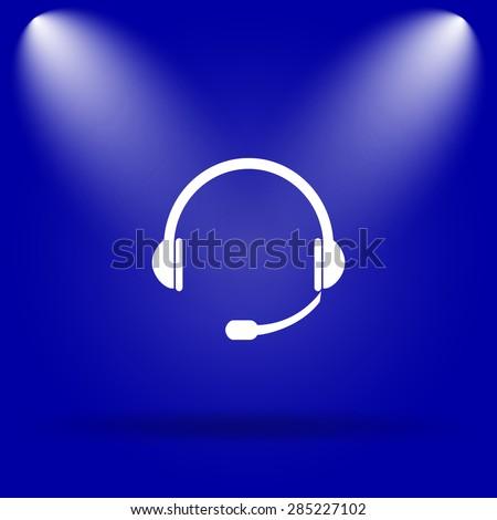 Headphones icon. Flat icon on blue background.  - stock photo