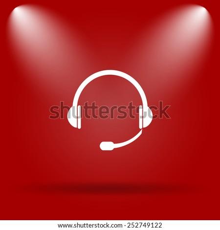 Headphones icon. Flat icon on red background.  - stock photo