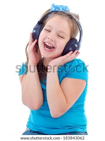 Headphones,musik,girl,child and kid - Little child in headphones isolated on white - stock photo