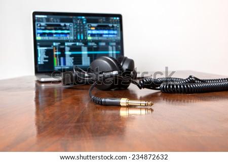 Headphones on a laptop computer - stock photo