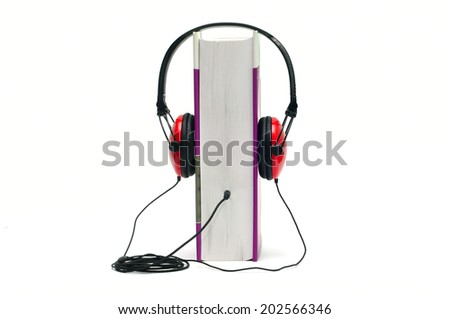 Headphones on book isolated on white representing audiobook concept - stock photo