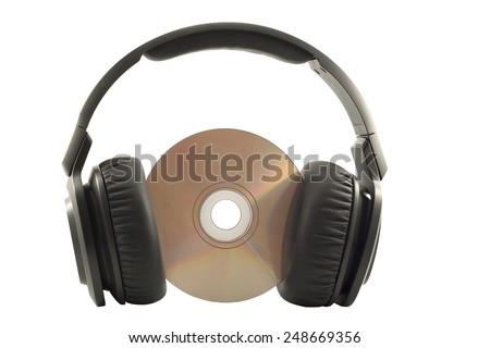 Headphones on compact disk  against white background - stock photo