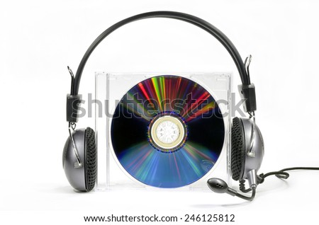 Headphones on compact disk in box against white background - stock photo
