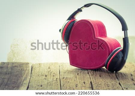 Headphones with red  heart. love music. vintage retro - stock photo