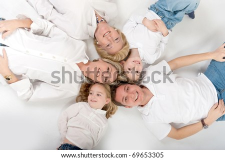 Heads of family members close together forming a circle - stock photo
