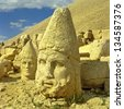 Heads of the statues on Mount Nemrut in Turkey, UNESCO World Heritage Site - stock photo