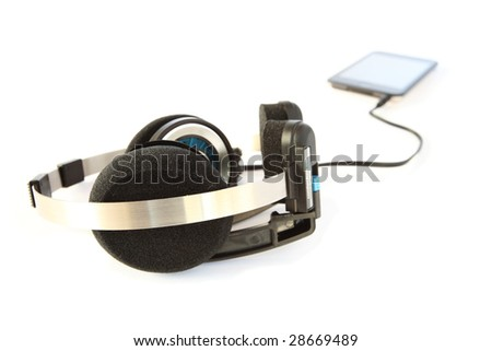 Headset and mp3 player on white - stock photo