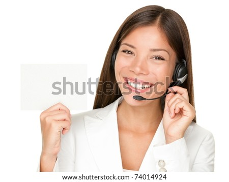 Headset. Customer service operator woman from call center smiling with headset showing blank empty sign card for copy space. Beautiful mixed race Asian Caucasian woman isolated on white background. - stock photo