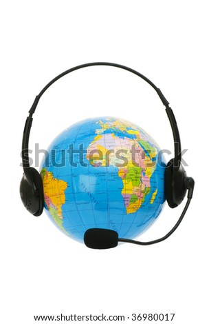 Headset on globe isolated on the white