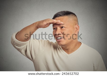 Headshot happy middle aged man searching looking far away into future monitoring isolated grey background. Human face expression emotion body language. Curiosity  forecast vision perception concept - stock photo