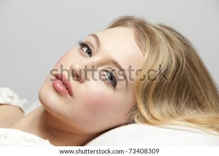Headshot of a beautiful blonde woman - stock photo
