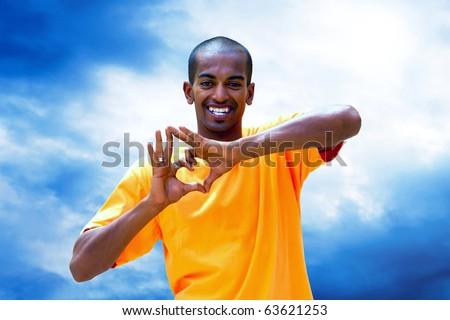 Headshot of a Black Man Smiling - stock photo
