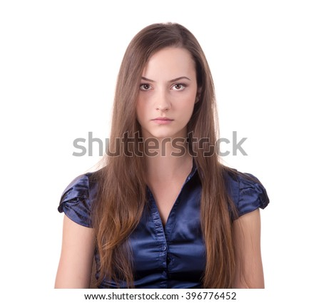 Headshot of a brown hair lady looking at the camera - stock photo