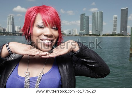 Headshot of a fashionable woman with red hair - stock photo