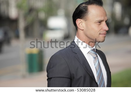 Headshot of a handsome businessman outside