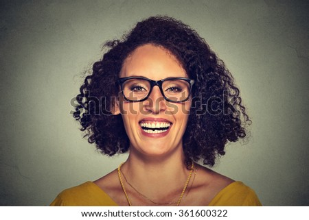 Headshot of a happy smiling woman in glasses isolated on gray wall background. Positive face expression  - stock photo