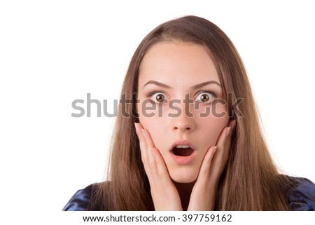 Headshot of a lady looking surprised with hands on her face.