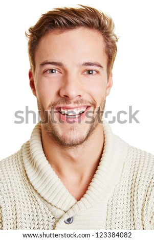 Headshot of a young happy smiling man - stock photo