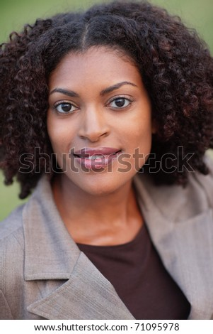 Headshot of an attractive black businesswoman - stock photo