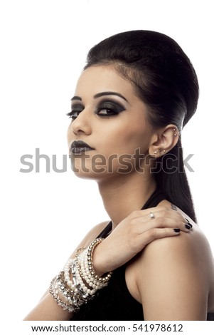 Headshot of attractive dark haired beauty isolated on white background