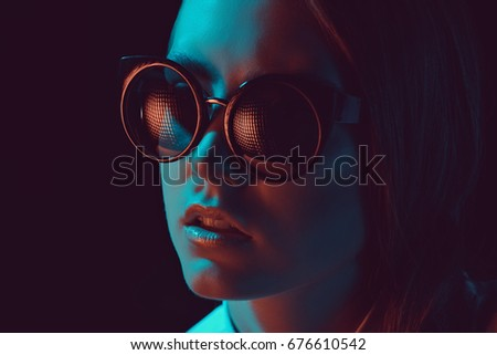 headshot of fashionable young caucasian woman in stylish sunglasses