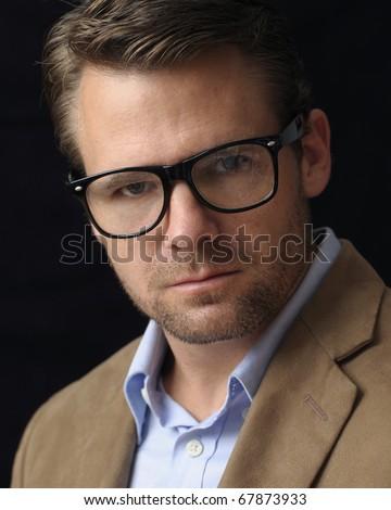 Headshot of male caucasian professor with glasses - stock photo