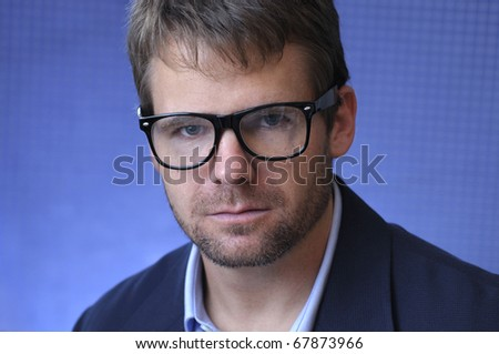 Headshot of male caucasian scientist with glasses - stock photo
